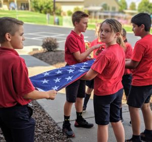 Folding the Flag St. Joseph Wenatchee